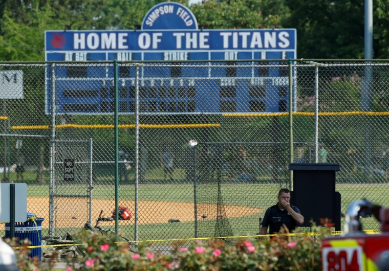 Image: Police investigate a shooting scene after a gunman opened fire on Republican members of Congress during a baseball practice in Alexandria, Virginia