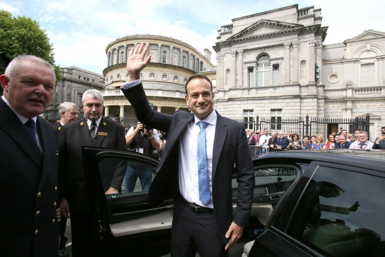Leo Varadkar waves to colleagues as he leaves the parliament in Dublin after being confirmed as taoiseach (prime minister) on June 14, 2017.