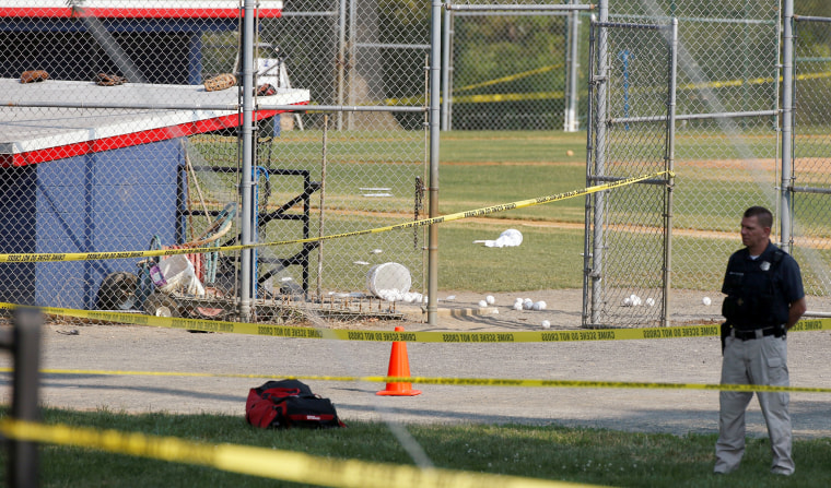 Image: A police officer guards the shooting scene after a gunman opened fire on Republican members of Congress during a baseball practice in Alexandria, Virginia