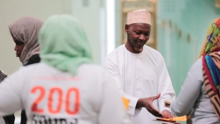 """An imam receives cards from DoSomething.org's """"Sincerely, Us"""" project. The project hopes to send cards to each mosque in the U.S. during the month-long Ramadan."""
