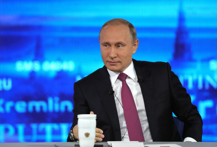 Image: Russian President Vladimir Putin listens during his annual televised call-in show in Moscow