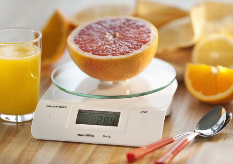 Image: Half of an orange on kitchen scale