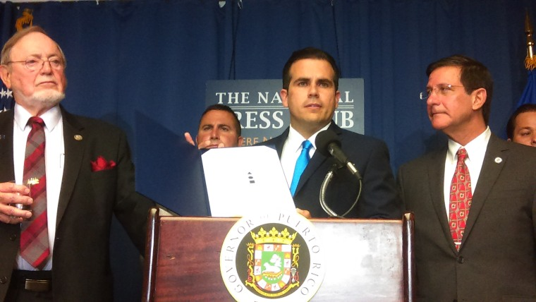 Puerto Rico Governor Ricardo Rossell?, accompanied by island officials and Reps. Don Young (R-AK) and Darren Soto (D-FL) at a press conference June 15, 2017 in Washington, D.C.  to officially present the results of the June 11 island plebiscite.