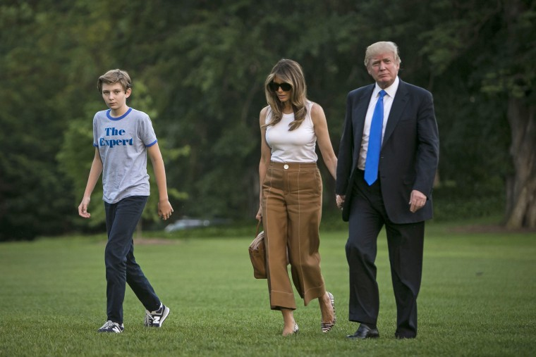 Image: President Donald Trump with first lady Melania Trump and Barron Trump after they arrived on Marine One at the White House in Washington