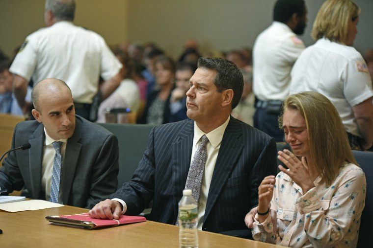 Image: Michelle Carter, right, seated with her attorneys Cory Madera, left, and Joseph Cataldo