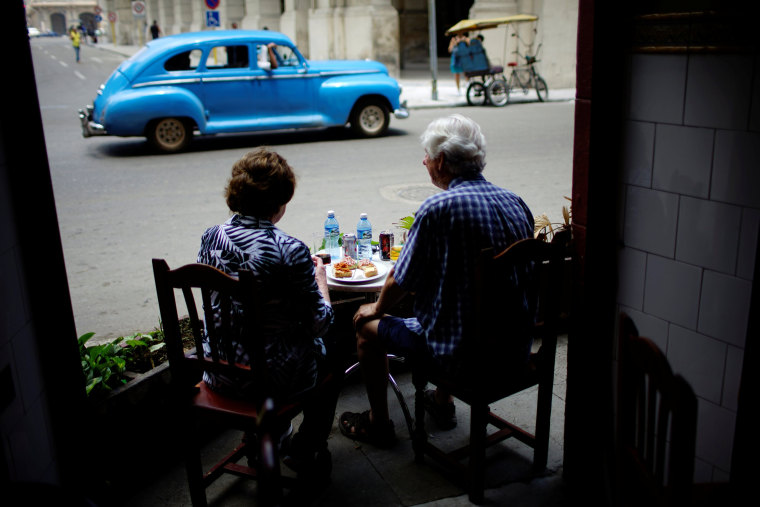 Image: Tourists eat in a restaurant in Havana, Cuba