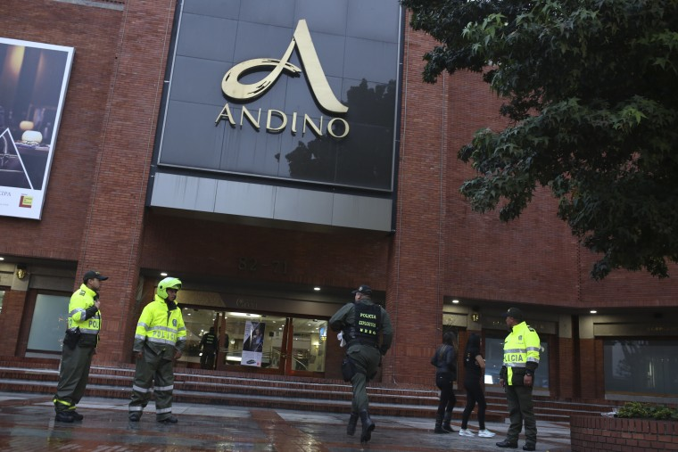 A member of the police bomb squad rushes to the Centro Andino shopping mall in Bogota, Colombia, after an explosion Saturday, June 17, 2017.