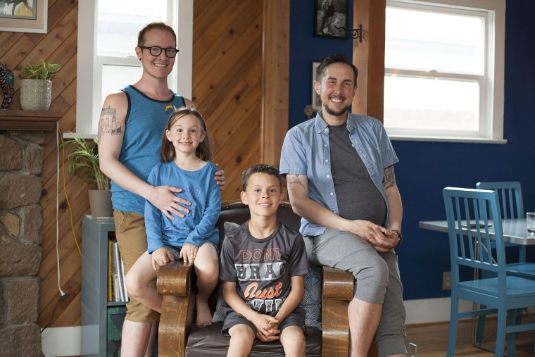Fathers Biff Chaplow (left) and Trystan Reese (right) with their children Hailey and Riley