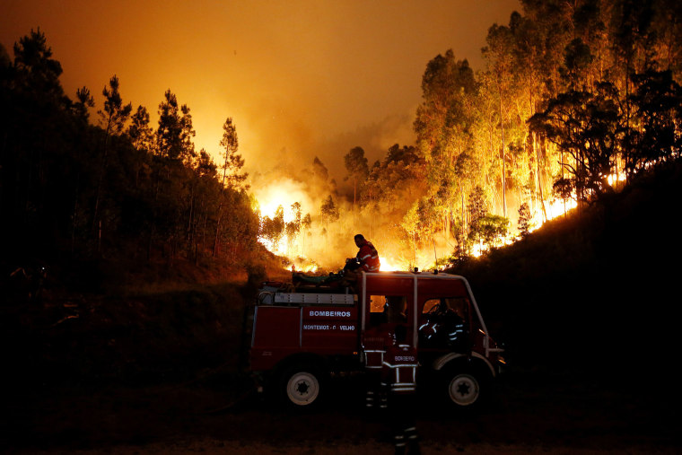 Image: Firefighters work to put out the fire near Bouca, in central Portugal, June 18.