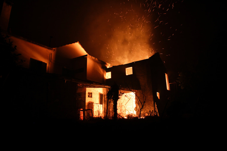 Image: A house burns in Figueira, near Pedrogao Grande, June 17.