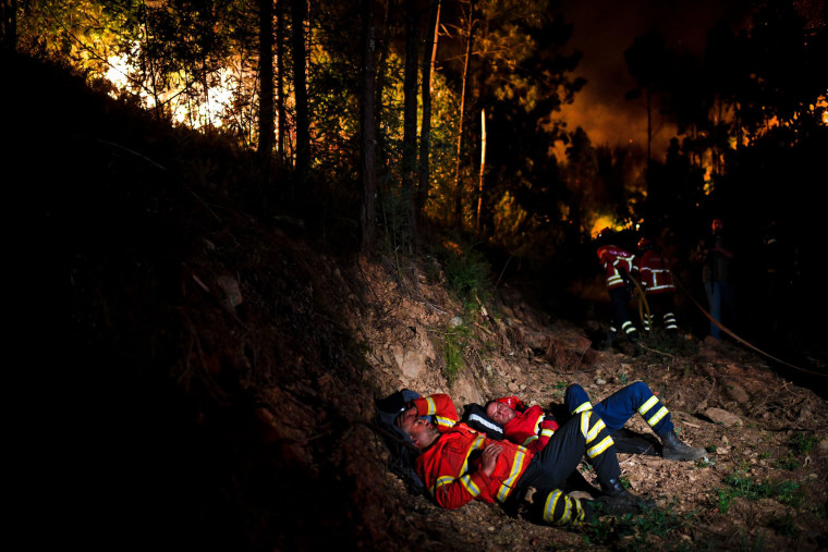 Image: Firefighters rest at Penela, Coimbra, central Portugal, on June 18.