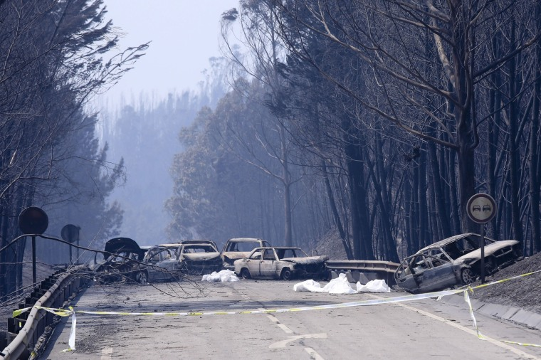 Image: Burnt cars and body bags lay on the N236 road between Figueiro dos Vinhos and Castanheira de Pera, June 18.