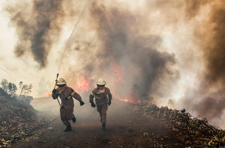 Image: National Guard soldiers battle the fire in Capela Sao Neitel, June 18.