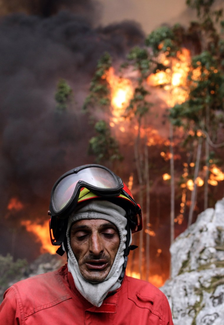Image: A firefighter reacts while battling the blaze in Vale das Porcas, Alvaiazere, central Portugal, June 18.