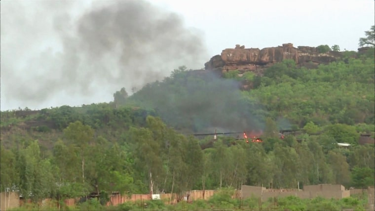Image: Flames rise following an attack where gunmen stormed Le Campement Kangaba resort in Dougourakoro, to the east of the capital Bamako, Mali in this still frame taken from video