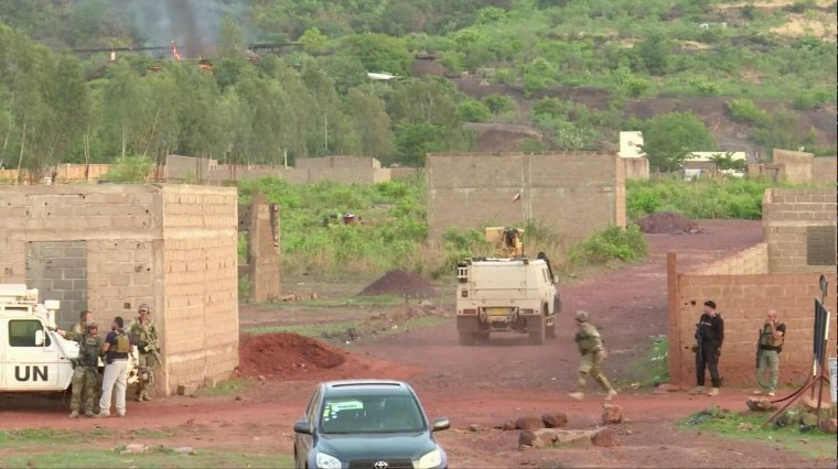 Image: An armoured vehicle drives towards Le Campement Kangaba resort following an attack where gunmen stormed the resort in Dougourakoro, to the east of the capital Bamako, Mali in this still frame taken from video