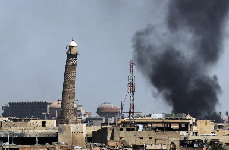 Image: A general view shows smoke billowing from Mosul's Old City