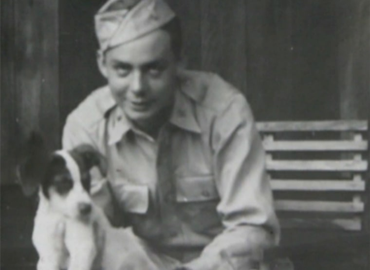 Russ Gremel with Rebel the dog, in Hawaii in 1941.