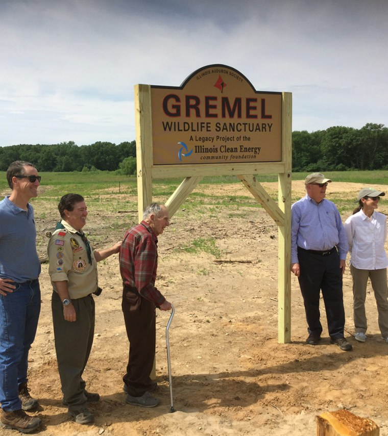Russ Gremel at the sign for the Gremel Wildlife Sanctuary.
