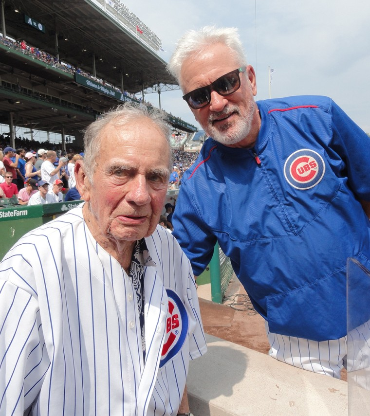 Russ Gremel at Chicago Cubs game with manager Joe Maddon.