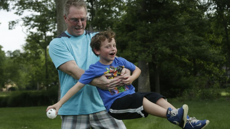 Dean Cravens makes sure his 5-year-old neighbor Brian Kelly is having fun while Brian's dad is overseas.