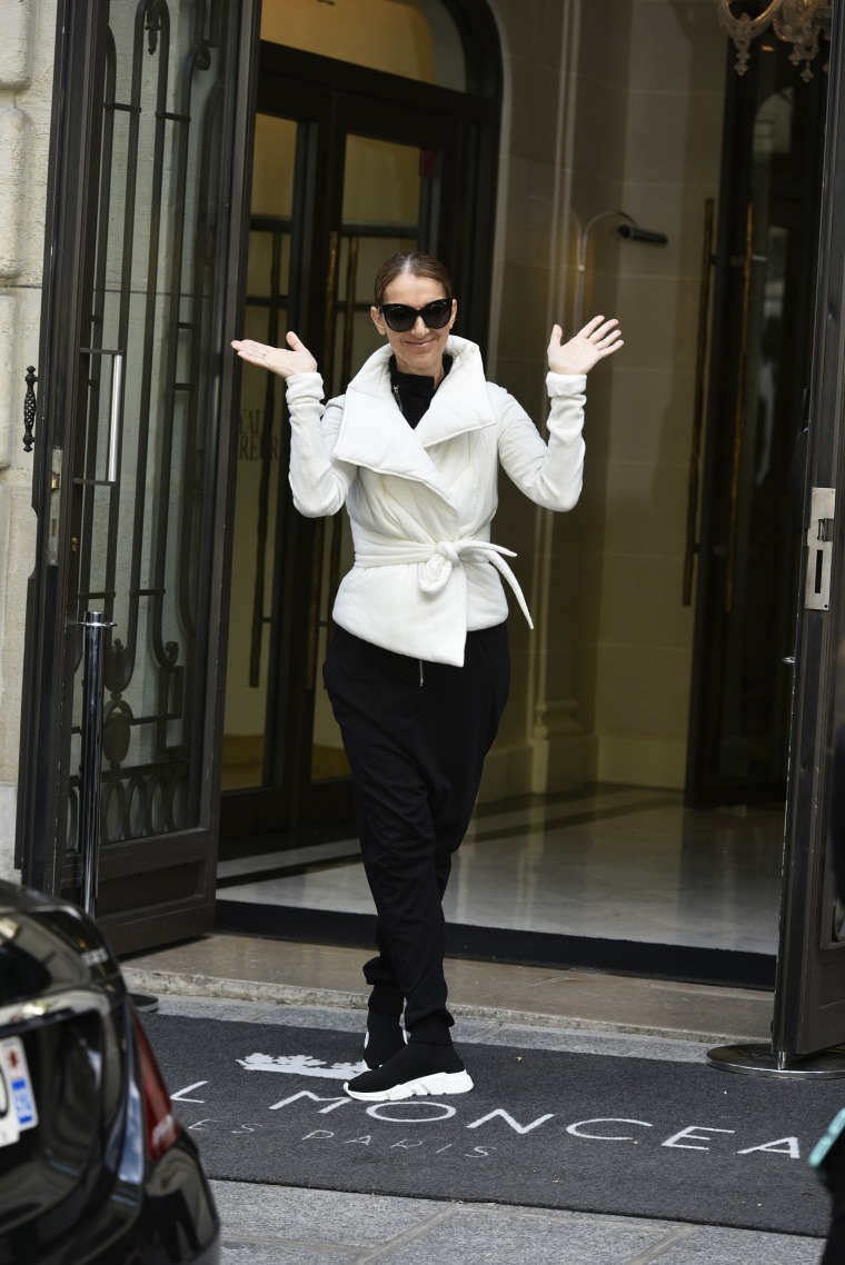 Celine Dion poses as she leaves her hotel in Paris, France