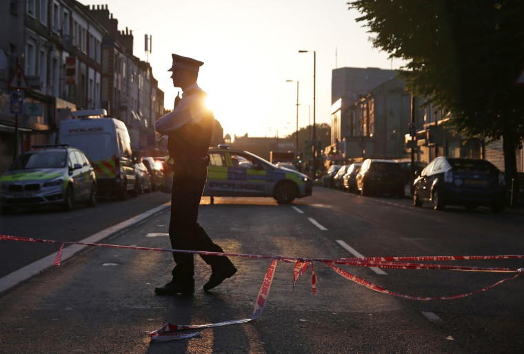 Image: A police officer guards a street in the Finsbury Park area