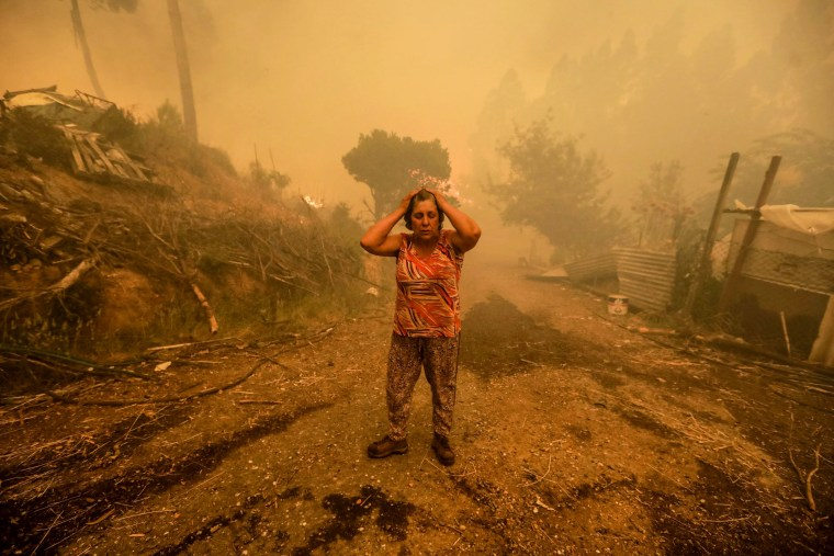 Image: A woman reacts in Pampilhosa da Serra, central Portugal on June 18.