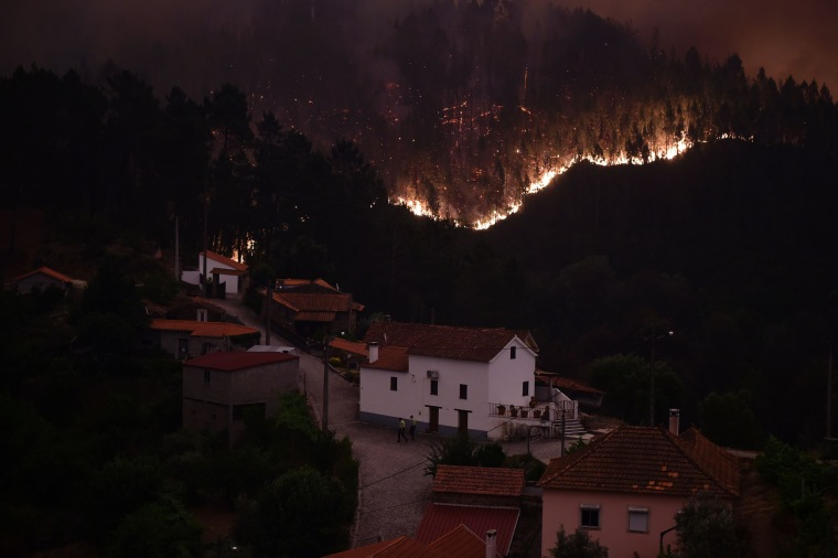 Image: Flames and smoke near the village of Mega Fundeira on June 18.