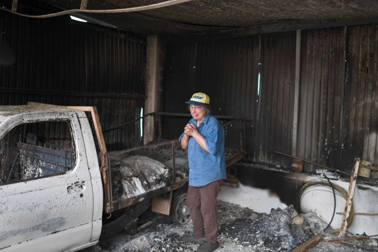 Image: Isabel Godinho, 63 years old, cries inside her burnt garage at Vilas de Pedro in Figueiro dos Vinhos on June 19.