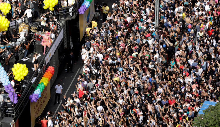 Image: Revellers take part in the Gay Pride parade along Paulista Avenue in Sao Paulo,