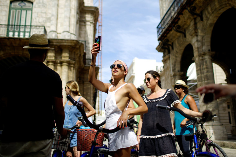 Image: Jamie Heifitz of the U.S. and her friends take a guided bicycle tour in Havana