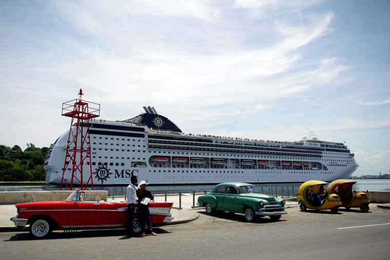 Image: Taxi drivers wait for custumers as cruise ship MSC Opera arrives in Havana