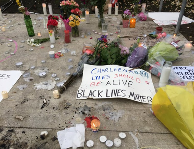 Candles and flowers form an impromptu memorial to Charleena Lyles in Seattle.