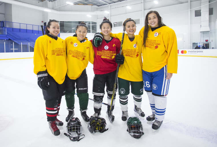 A group of female hockey players of Chinese descent participating in a training camp hosted by the China national hockey team.