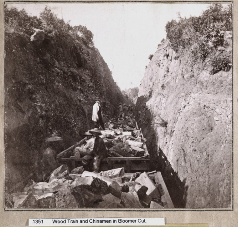 Chinese railroad workers on a wood train in Bloomer Cut, a rail passage in California.