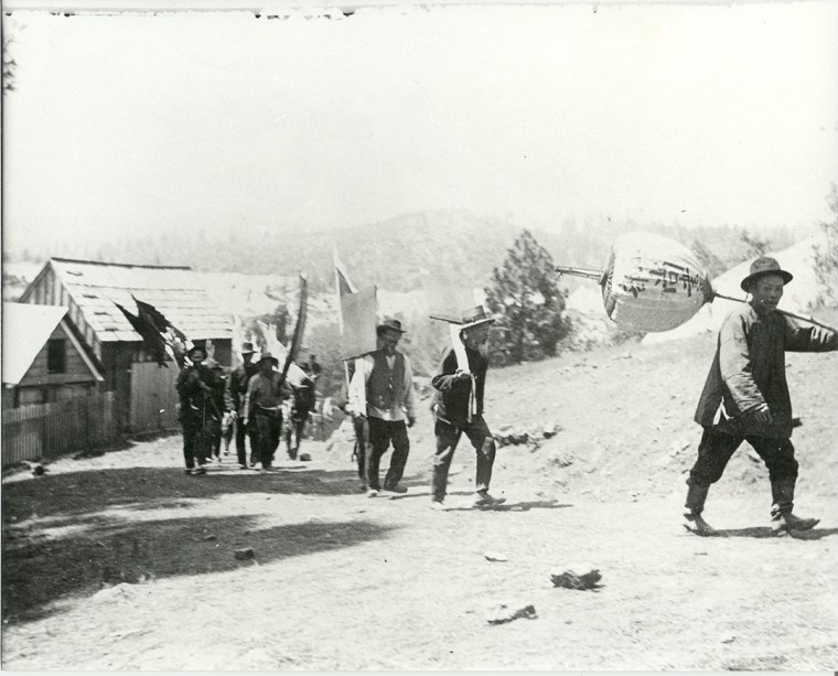 A funeral procession of Chinese railroad workers near Dutch Flat, California.