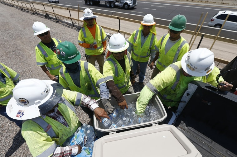 Image: Construction workers take a water break