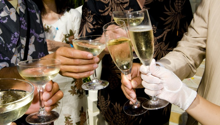 Image: Wedding guests toast with champagne