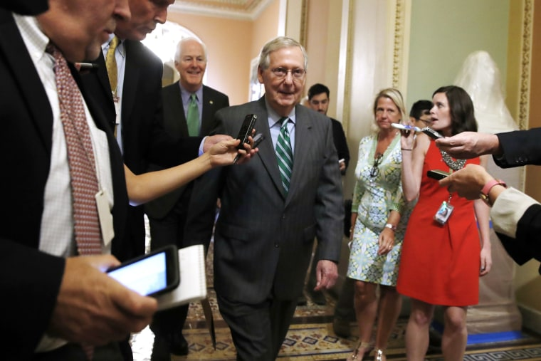 Image: Mitch McConnell leaves a Republican meeting on healthcare
