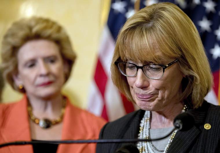 Image: Sen. Maggie Hassan, accompanied by Sen. Debbie Stabenow pauses while speaking during a news conference