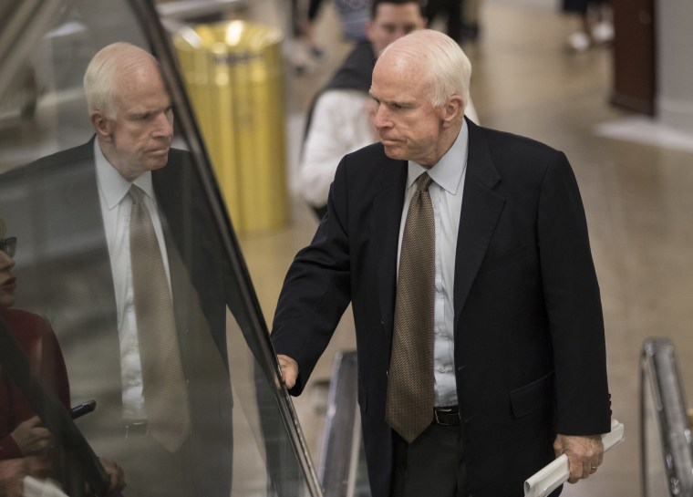 Image: Senate Armed Services Committee Chairman John McCain, R-Ariz., arrives at the Capitol