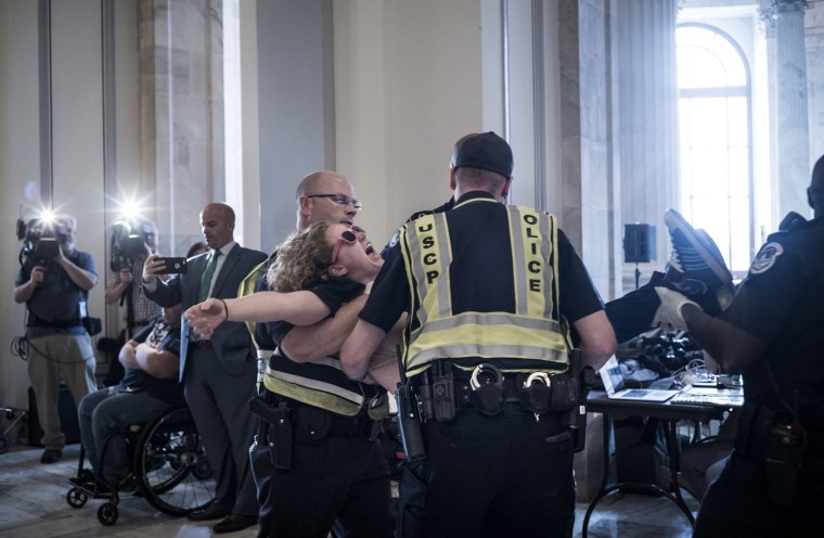 Image: U.S. Capitol Police remove a protester from the Russell office building on Capitol Hill