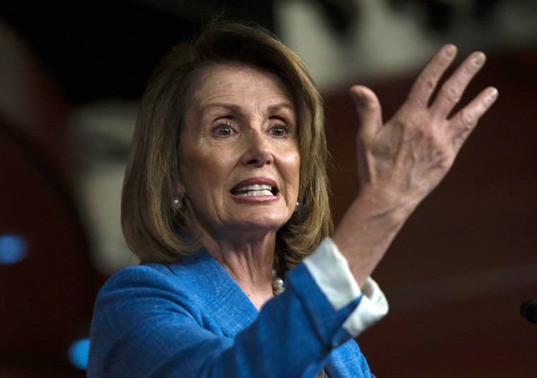 Image: House Minority speaker Nancy Pelosi gestures during a press conference