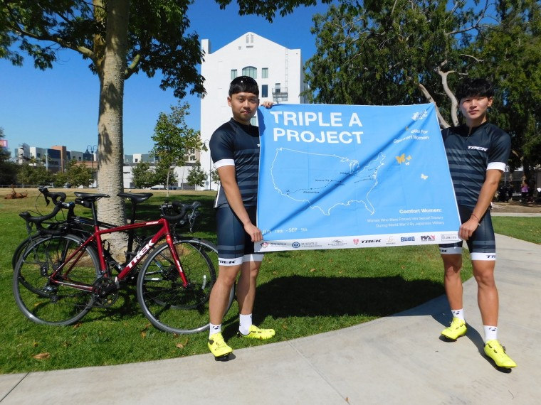 "Joo-young Ha (left), 25, and Yong-joo Jo (right), 21, will cycle 3,728 miles from Los Angeles to New York as part of a campaign called the Triple A Project (TAP) to raise awareness about ""comfort women."" The three As of the campaign stand for admit, apologize and accompany."