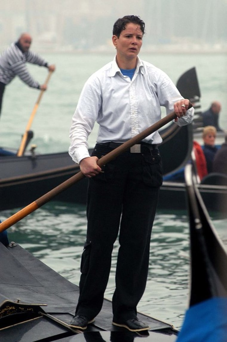 Alex Hai is seen as he rows on a gondola in Venice in an undated file photo.