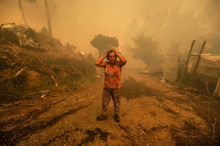 Image: A woman reacts to a forest fire in Portugal