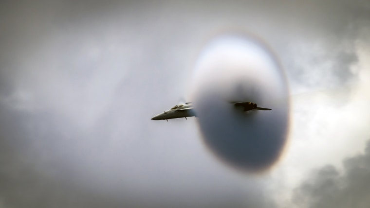 Image: A fighter aircraft conducts a high-speed flyby