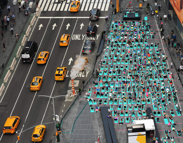 Image: People practice yoga in Times Square