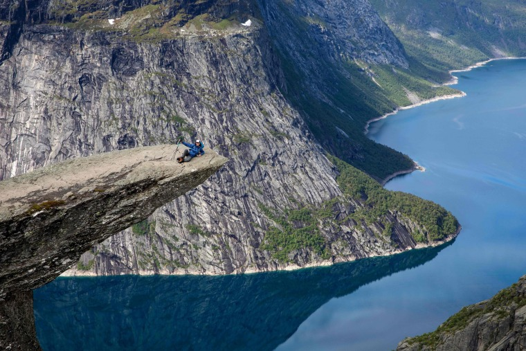"Image: Tourists visit the ""Trolltunga"" rock in Norway"